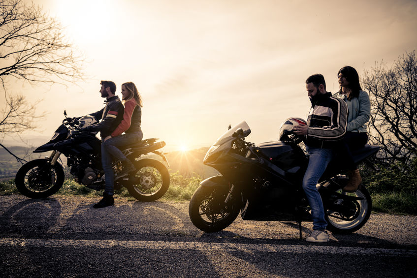 Two motorbikes driving in the nature - Friends driving racing motorcycles with their girlfriends - Group of bikers stop in a panoramic view point and look at suggestive sunset, Tips for riding motorcycles in a group